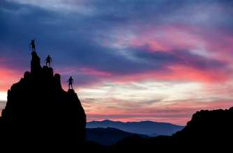 Three climbers and a sunset